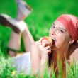 Stock Photo: Girl in kerchief with apple