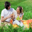 Long-haired girl with boy on grass — Stock Photo