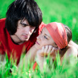 Long-haired girl with boy on grass — Stock Photo #3371519
