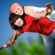 Long-haired girl with boy on grass — Stock Photo #3371752