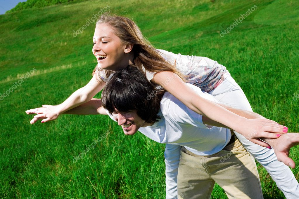 Long-haired girl with boy on grass — Stock Photo #3371940