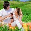 Nice girl and boy on grass — Stock Photo