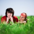 Boy and smiling girl on grass — Stock Photo