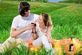 Nice girl and boy on grass — Stock Photo