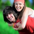 Smiling girl with boy on grass - Stock Photo