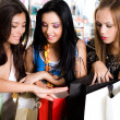 Three girls are shopping — Stock Photo