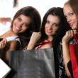 Three girls with bags — Stock Photo