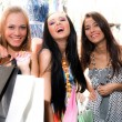 Smiling girls with bags — Stock Photo