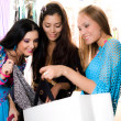 Three smiling girls are shopping — Stock Photo