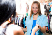 Girl with smile is shopping — Stock Photo