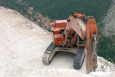 Digger on high ledge — Stock Photo