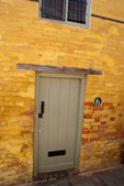 Door to a yellow brick house — Stock Photo