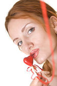 Beautiful woman kissing the red heart — Stock Photo