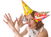 Joking woman in three party hats — Stock Photo