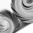 Stock Photo: Rolled up magazines