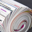Stock Photo: Rolled up magazine