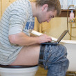 Blogger in toilet — Stock Photo