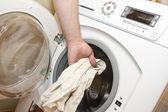 Loading the washing machine — Stock Photo