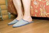 Man's legs in slippers — Stock Photo