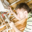 Stockfoto: Plumber at work. Servicing gas boiler