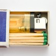 Cigarette lighter and matches in matchbox — Stock Photo