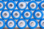 Blue batteries background — Stock Photo