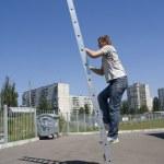 Man climbing ladder — Stock Photo #3320447