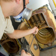 Repair man servicing big gas boiler — Stock Photo