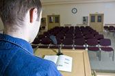 Speaker at work and empty auditorium — Stock Photo