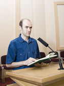 Speaker at work near the microphone — Stock Photo