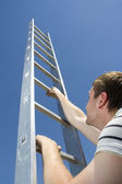 Man climbing ladder — Stock Photo
