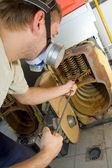 Repair man servicing big gas boiler — Stock Photo