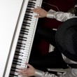 playing the piano — Stock Photo