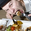 Stock Photo: Really hungry man