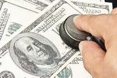 Examination of the US dollars — Stock Photo