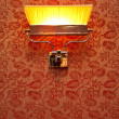 Stock Photo: Vintage night lamp on wall