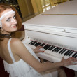 Retro woman playing the piano — Stock Photo