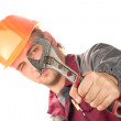 Working man with adjustable wrench — Stock Photo #3605723