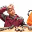 Tired working man with tools — Stockfoto