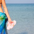 Woman with flip flops — Stock Photo