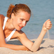 Woman with sand in hand — Stock Photo