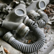 Abandoned gas masks — Stock Photo