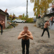 Постер, плакат: Street fighter practicing Karate