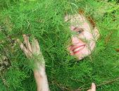 Woman in thuja tree — Stock Photo