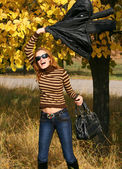 Fun young woman in park — Stock Photo
