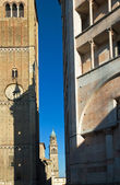 Italian bell towers and baptistery — Stock Photo