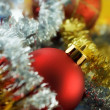 Christmas bauble among tinsel - Stock Photo