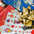 Stock Photo: Golden ribbon on wrapping paper