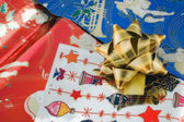 Golden ribbon on wrapping paper — Stock Photo
