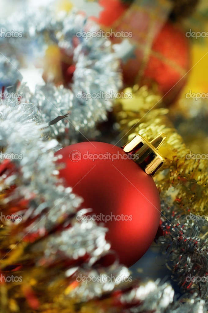 Christmas bauble among tinsel with very shallow depth of field and glow effect  Stock Photo #2778171